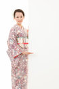 Beautiful kimono woman and white board young asian holding hands Stock Photos