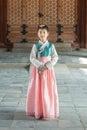 Beautiful Korean girl in Hanbok at Gyeongbokgung, the traditional Korean dress Royalty Free Stock Photo