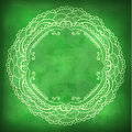Beautiful lace frame on a green background with grunge effects. Royalty Free Stock Photo