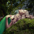 Beautiful lady in the coniferous forest portrait of elegant woman with luxurious hair a Stock Photos