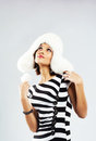 Beautiful lady in furry earflapped cap Stock Photography