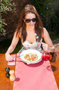 Beautiful lady having lunch and wine on terrace Royalty Free Stock Photo