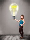 Beautiful lady holding realistic d light bulb young Stock Photography