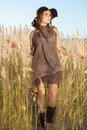 Beautiful lady model going through meadow wilds Royalty Free Stock Image