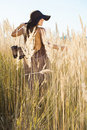 Beautiful lady model walking through meadow wilds at midday with shoes off Stock Photography