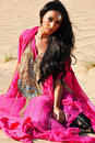 Beautiful lady in pink dress in  desert Royalty Free Stock Images