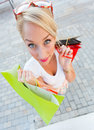 Beautiful lady shopping woman with big blue eyes holding bags Royalty Free Stock Photo
