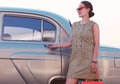 Beautiful lady standing near retro car Royalty Free Stock Photo