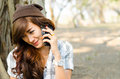 Beautiful lady talking on phone in the park Royalty Free Stock Images