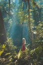 Beautiful lady in tropical forest young red dress Stock Photography