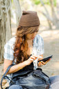Beautiful lady useing smart phone under a tree Royalty Free Stock Image
