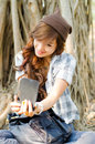 Beautiful lady useing smart phone under a tree Stock Photos