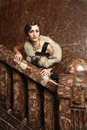 Beautiful lady waiting on the staircase Royalty Free Stock Photo