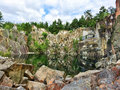 Beautiful lake in the ancient stone quarry sweden surrounded by rocks and trees abandoned many years ago Stock Photos