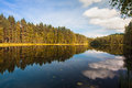 Beautiful lake in finland view with the reflection of the forest Royalty Free Stock Photos