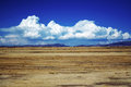 Beautiful landscape with big white clouds and blue sky Stock Photography