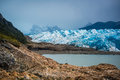 Beautiful landscape of a blue glacier and mountains with a bay. Shevelev. Royalty Free Stock Photo