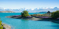 Beautiful landscape of garden, lake and snow mountain at Lake Tekapo, South Island, New Zealand Royalty Free Stock Photo