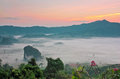 Beautiful landscape of misty valley and sierra in thailand photograph from tourist view a resort northern imaging by hdr Stock Image