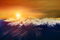 Beautiful landscape sun rising sky over snowcaped mountain Royalty Free Stock Photo