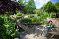 Beautiful landscaped garden trees pond bridge over pond Royalty Free Stock Photography