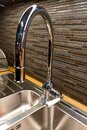 Beautiful large convenient kitchen faucet Royalty Free Stock Photo