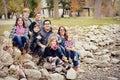 Beautiful large family sitting on rocks Royalty Free Stock Photo