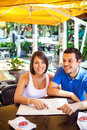 Beautiful latin couple in a restaurant an outdoors restaurantready to order Stock Photography