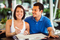 Beautiful latin couple in a restaurant an outdoors sushi ready to roder Royalty Free Stock Images
