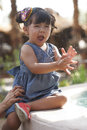 Beautiful latina girl hispanic toddler happily playing with water from fountain Royalty Free Stock Photography