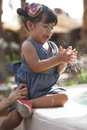 Beautiful latina girl hispanic toddler happily playing with water from fountain Royalty Free Stock Photos