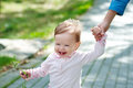 Beautiful laughing baby walking outdoors