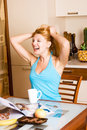 Beautiful laughing girl in the kitchen Stock Photography