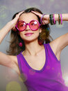 Beautiful laughing girl in pink sun glasses Stock Photos