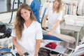 Beautiful laundry employee smiling coleague in background Royalty Free Stock Photo