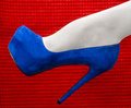 Beautiful leg in a high heeled shoe young woman white stockings and blue Royalty Free Stock Photo
