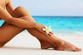 Beautiful legs on the beach Royalty Free Stock Photo