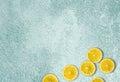 Beautiful light Blue Background with fresh lemon slices Royalty Free Stock Photo