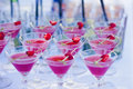 Beautiful line of different colored alcohol cocktails with smoke on a christmas party tequila martini vodka and others on part Royalty Free Stock Photography