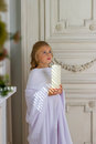 Beautiful little angel with candle praying Royalty Free Stock Photo