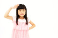 Beautiful little asian girl in a salute Royalty Free Stock Images