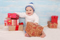 Beautiful little baby with gift