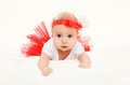 Beautiful little baby girl lying in red skirt Royalty Free Stock Photo