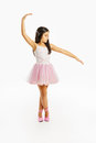 Beautiful little ballerina dancer wearing lovely tutu dancing like a swangirl Stock Photo