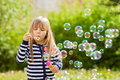Beautiful little blonde girl, playing outdoor, springtime Royalty Free Stock Photo
