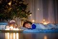 Beautiful little child, boy, lying down on the floor,sleeping un Royalty Free Stock Photo