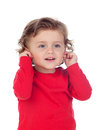 Beautiful little child two years old touching his ears Royalty Free Stock Photo
