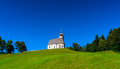 Beautiful little church in Alps. Sunny day, green grass on the h Royalty Free Stock Photo