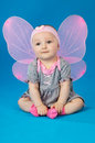 Beautiful little fairy baby pretty on a blue background Stock Photo