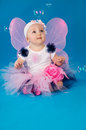 Beautiful little fairy on a blue background with soap bubbles Royalty Free Stock Photography
